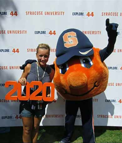 Inclusive U student Megan poses with Otto the Orange holding a class of 2020 sign