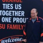 Andrew Benbenek and SU banner
