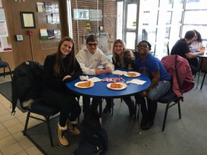 On Campus students pose at a lunch table