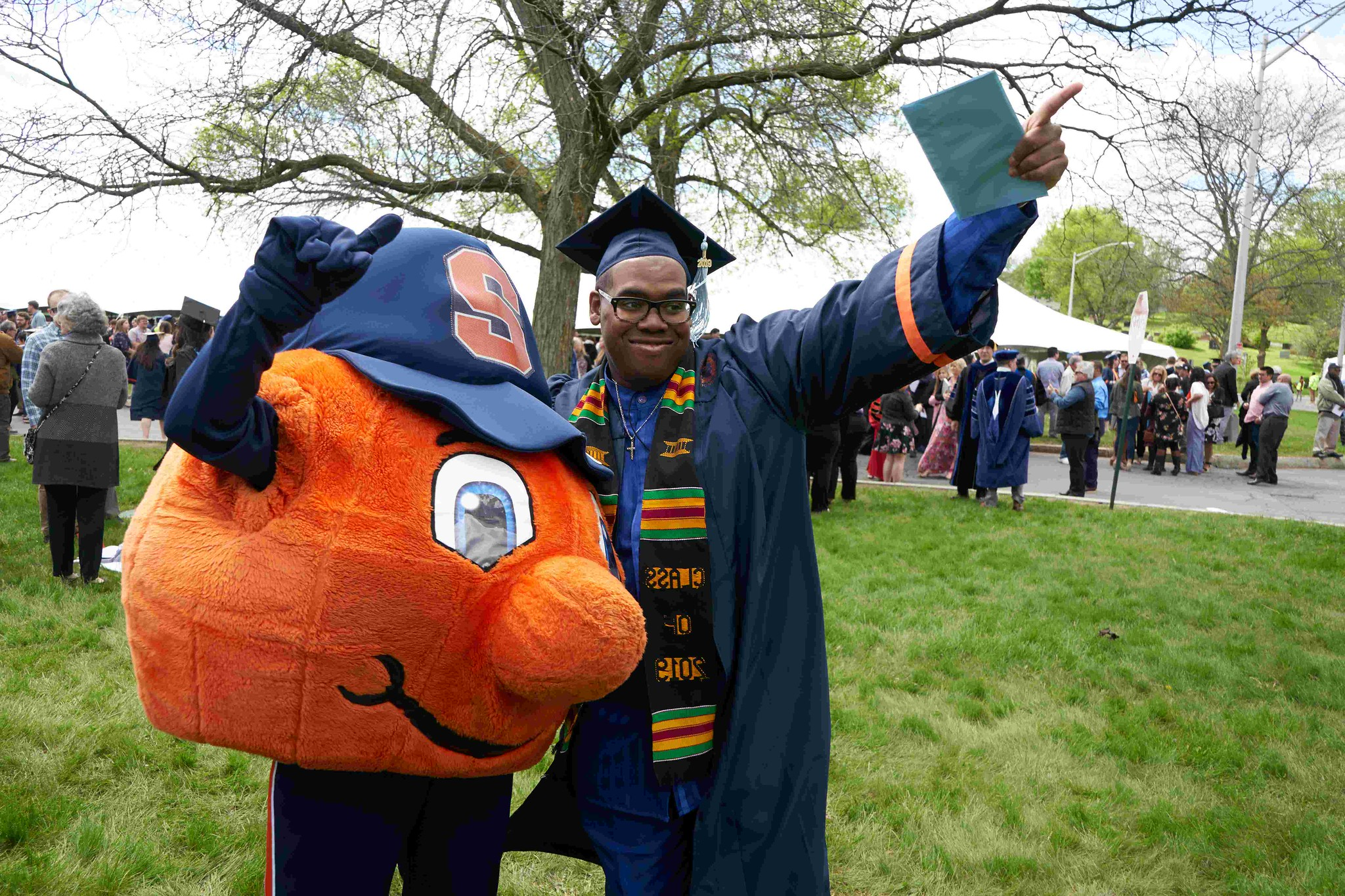 InclusiveU student at graduation with Otto the Orange