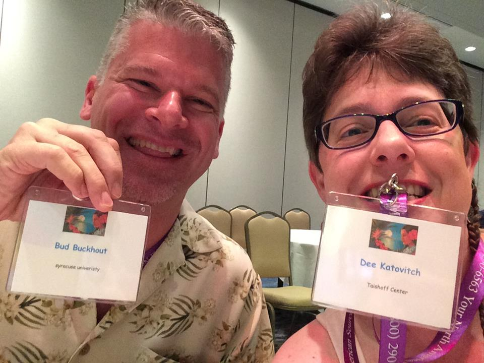 Bud Buckhout and Dee Katovitch selfie holding their conference nametags