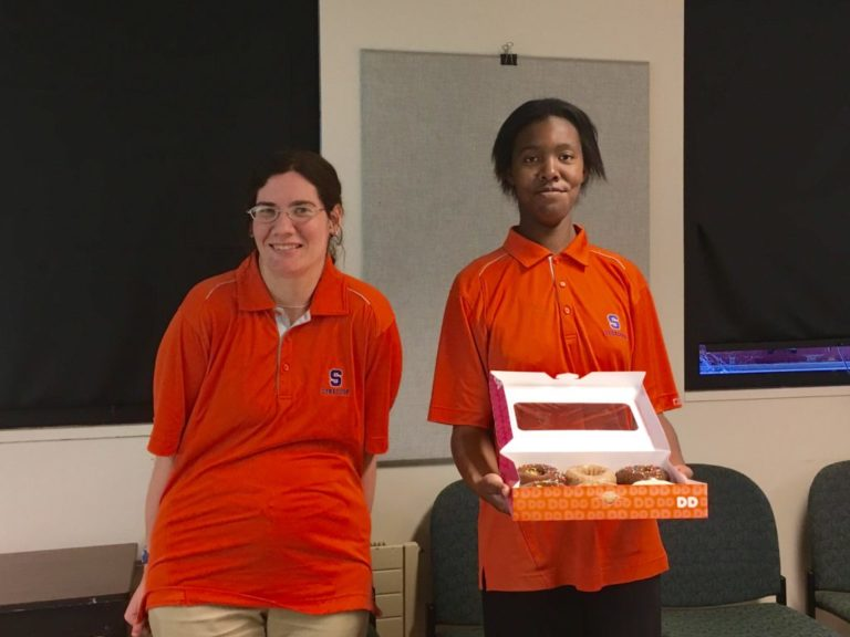 Two project search students in their intern uniforms